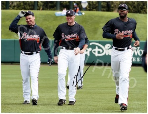 Chipper Jones, seen here mentoring Jason Heyward and Freddie Freeman, was at the tail end of the 14 straight NL East Division Titles for this given contract.  He was the premiere switch hitting slugger in the MLB, and his all around game helped the Braves dominate the NL East