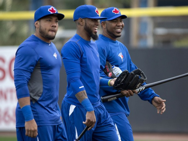 Melky Cabrera, Jose Reyes and Edwin Encarnacion. 3 of the first 4 hitters in the 2013 Toronto Blue Jays lineup, and all from the Dominican Republic. In their first year as teammates on the Blue Jays, and one of their first spring training practices, have already become a close trio. Dominican slugger Jose Bautista is missing from this photo, but is the 4th piece of this dazzling 1-4 combination.