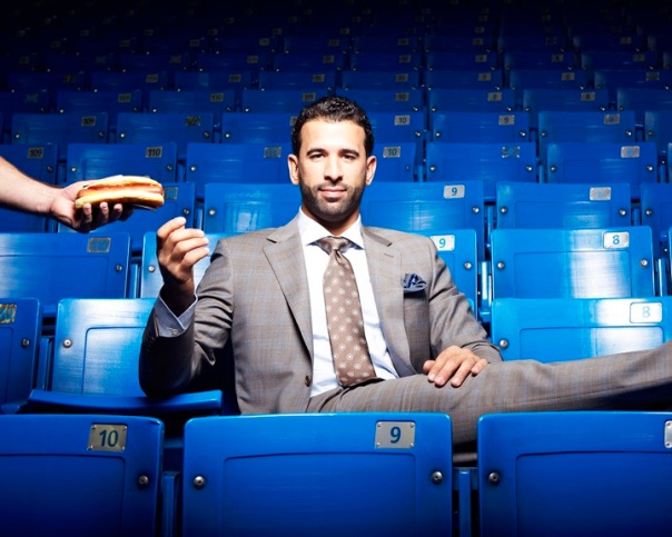 Jose Bautista doesn't always eat hotdogs in an empty Rogers Center, but when he does, he wears a suit.
