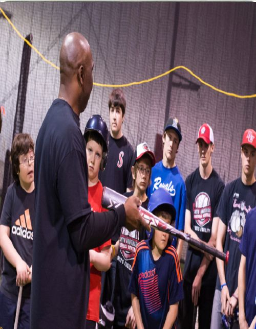 Mookie Wilson doing what he does best,  Teaching the proper fundamentals in the game of baseball to a group of young ballplayers.  Mookie devotes as much time as he can back to the game because he feels that is what you should do as an ex-player.