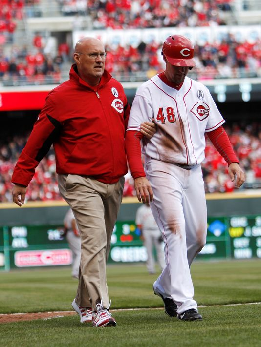 Reds left fielder Ryan Ludwick had to be taken off the field on Opening Day by trainer Paul Lessard due to a shoulder injury. He slid head first into Third Base and dislocated his right shoulder, tearing cartilage. The Reds will be without Ludwick for the next three months. Without his offensive production will the Reds stay atop of the National League Central.  The OF hit for a 3 Slash Line .275/.346/.877 - with 26 HRs and 80 RBI in just 422 At-Bats in 2012.  Ludwick signed a 2 YR deal with the Reds worth $15 MIL over the winter.