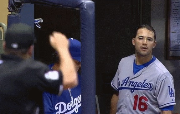 Andre Ethier gives the umpire a dead stare after being ejected from the game for arguing balls and strikes with the umpire. The Dodgers went on to lose that game to the Milwaukee Brewers 5-2.