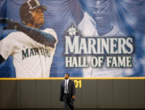 Former Mariners great, Ken Griffey Jr. walks in from center field as he is introduced during a ceremony inducting him into the Seattle Mariners Hall of Fame prior to the game against the Milwaukee Brewers at Safeco Field on August 10, 2013 in Seattle, Washington.