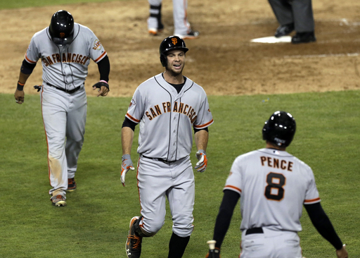 Brandon Belt had the quietest 60 Extra Base Hits in the MLB (17 HRs, 3 - 3B and 39 - 2B) during the 2013 year.  Here he is seen with Pence, who also hit 27 HRs without much fanfare.  Belt is doing even better so far this campaign - with 5 HRs, 9 RBI and a .625 SLG % through his 1st 48 AB.