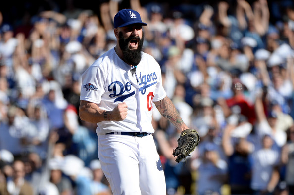 Brian Wilson was given a 1 YR/$10 MIL deal with the Dodgers, that also has him having a Player Option for the 2015 year at $9 MIL.  If Wilson has a great year in 2014, it will still benefit the Dodgers, but at the same time it may have been the deciding factor in retaining 'The Beard's' services.   Wilson has a 3.11 ERA in 333.2 IP worth of work in career, with 171 Saves in 196 Chances for an 87.2 % conversion Rate,  Wilson is a 3 Time ALL - Star and 2 time World Series Winner.  His winning pedigree will continue to be cherished in the Dodgers Pitching Relief Core.  Wilson 1st had TJ Surgery in 2003, and went for the procedure again in 2012.  He is among just a few relievers - who have 150+ Saves after the surgery.