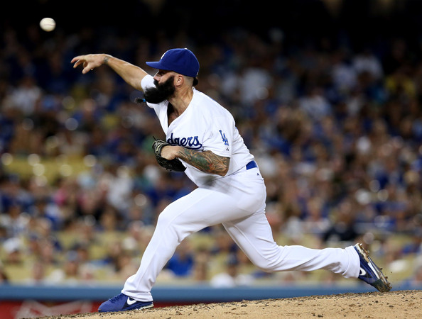 From 2008-2011, Brian Wilson was one of the top closers in the Majors with 163 Saves.  He Saved 48 Games with a 1.81 ERA only 3 years ago in  2010 for the World Champ Giants.  He went through TJ Surgery for a 2nd time in April of 2012 - who will give him a chance in 2014, by signing the pending Free Agent?  The Dodgers are hoping he can duplicate his 2013 performance, and any other year he has played a full campaign in recent memory. Wilson has pitched in 17.2 IP worth of work in his playoff Career, and has yet to give up