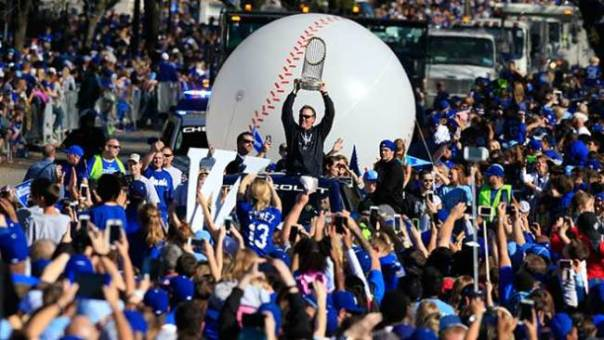 kansas-city-royals-manager-ned-yost-holds-the-world-series-trophy-during-a-victory-parade-in-kansas-city