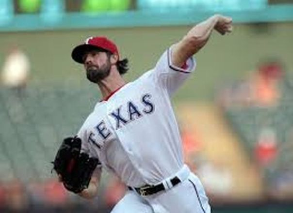 Cole Hamels was picked up at the Trade Deadline by the Rangers in 2015. He fashioned a 7 - 1 record with a 3.66 ERA and a WHIP of 1.191. This move was a perfect idea with the club's pending loss of Yovani Gallardo, coupled with the uncertainty of staff ace Yu Darvish coming back in time for the 2016 season from Tommy John Surgery. Including a subsidized stipend of $8.5 MIL from Philly this year, the LHP will earn just around $84 MIL over the next four years with the club. His playoff battled arm was put to the test again in the 2015 ALDS. He pitched to a 2.70 ERA in 2 Game Starts. Hamels can lead a rotation into a postseason.