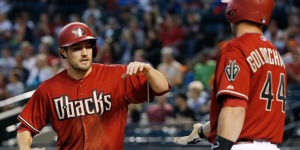 Arizona Diamondbacks' A.J. Pollock, left, slaps hands with Paul Goldschmidt (44) after Pollock scored a run against the San Francisco Giants during the first inning of a baseball game Wednesday, April 8, 2015, in Phoenix. (AP Photo/Ross D. Franklin)